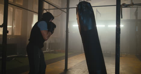 Boxer-Punching-Bag-in-Gym