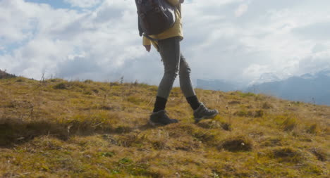Woman-Hiking-in-Alpine-Meadow-02