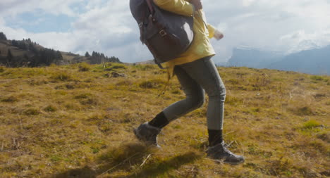 Woman-Hiking-in-Alpine-Meadow-03