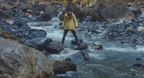 Woman-Crossing-Mountain-River-01