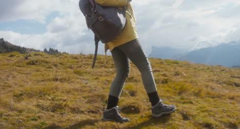 Woman-Hiking-in-Alpine-Meadow-04