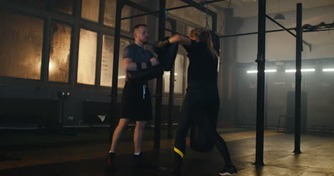 Woman-Ducking-and-Boxing-with-Coach