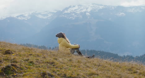 Woman-Sitting-on-a-Hillside-01