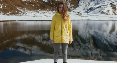 Woman-in-Front-of-Snowy-Lake-01