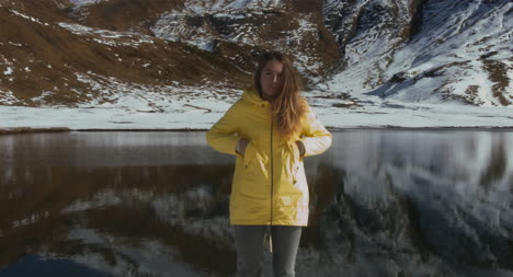 Woman-in-Front-of-Snowy-Lake-02
