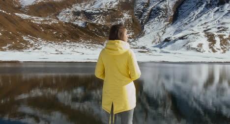 Woman-Looking-at-Lake