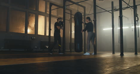 Woman-Boxing-Bag-with-Trainer-01