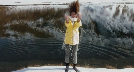 Woman-Throwing-Snow-02