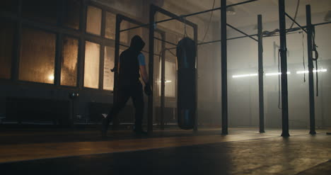 Boxer-Approaching-Punching-Bag