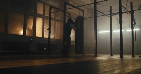 Man-Punching-Bag-in-Gym