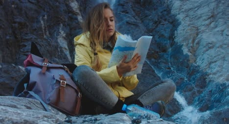 Hiker-Reading-Map-by-Waterfall-05