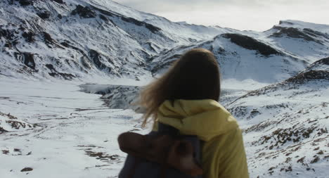 Woman-in-Snowy-Mountains
