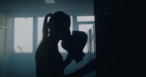 Throwing-Boxing-Gloves-into-Locker