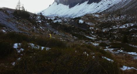 Woman-Walking-Through-Mountains