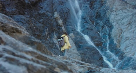 Hiker-By-Waterfall