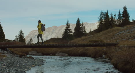 Hiker-Crossing-Stream-01