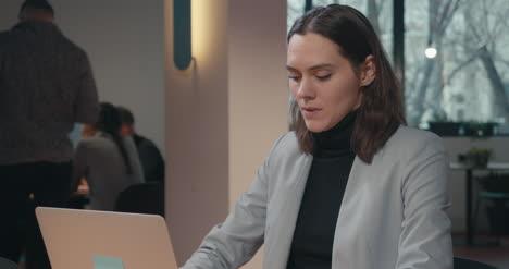 Woman-in-Suit-With-Laptop-02