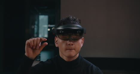 Young-Man-Using-VR-Headset