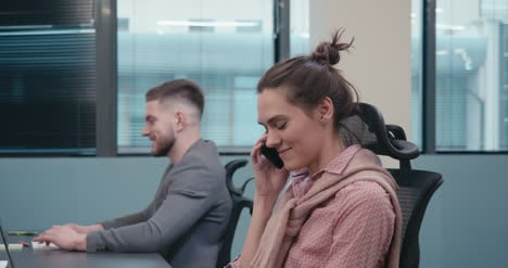 Office-Worker-Answers-Phone-03