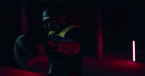 Man-Holding-American-Football-01