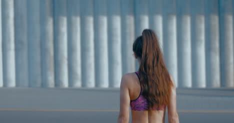 Frau-In-Sportkleidung