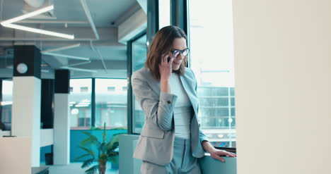 Happy-Businesswoman-on-Phone