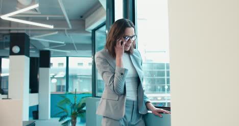 Happy-Businesswoman-on-Phone