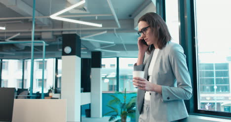 Businesswoman-on-Phone-with-Coffee