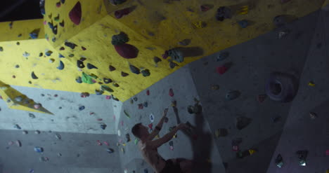 Man-Starts-Climbing-Wall