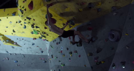 Man-Climbing-in-Gym