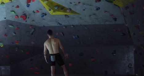 Man-Preparing-to-Climb-Wall