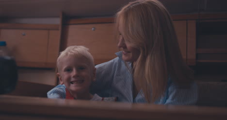 Mother-and-Son-in-Yacht-Cabin-01