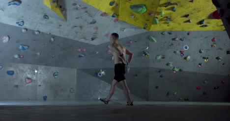 Climber-Approaches-Climbing-Wall