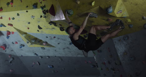 Man-Bouldering-in-Climbing-Gym