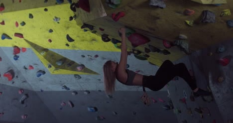 Woman-Bouldering-on-Wall