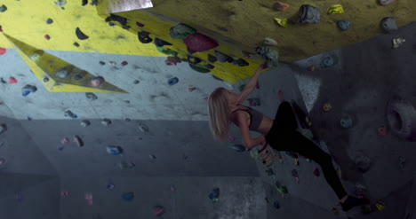 Woman-Using-Chalk-on-Climbing-Wall