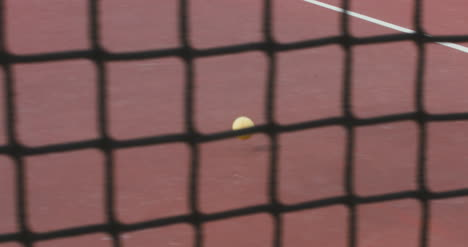 Tennis-Ball-Rolling-Across-Court-01