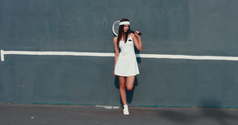 Tennis-Girl-Leans-on-Wall-01