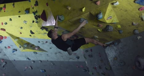 Man-in-Climbing-Gym