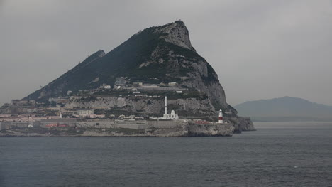 Gibraltar-Rock-End-With-Lighthouse-And-Mosque-Drift-Past