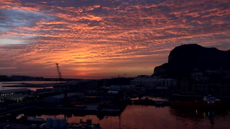 Gibraltar-Rock-With-Bright-Sunrise-Clouds-Time-Lapse-View