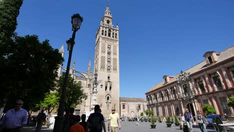 Seville-Giralda-Tower-With-Street-Light-And-Tourists