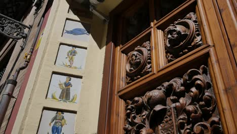 Seville-Carved-Door-And-Paintings