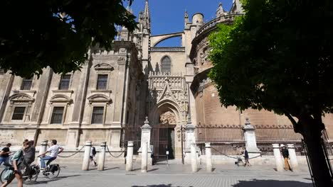 Seville-Cathedral-With-Bicycles-Going-By