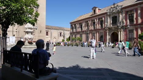 Seville-Plaza-And-Archbishops-Palace-With-People-On-Bench