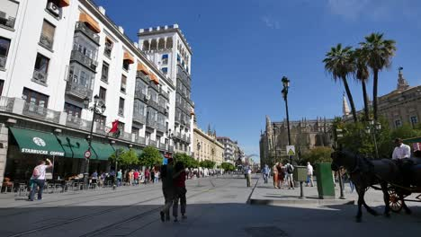 Seville-Street-With-People-And-Carriage