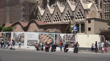 Spain-Barcelona-Sagrada-Familia-Pedestrians-And-Posters