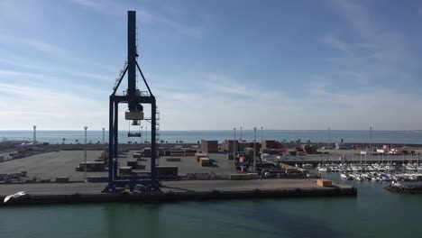 Spain-Cadiz-Passing-A-Loading-Crane-And-Pleasure-Boat-Harbor