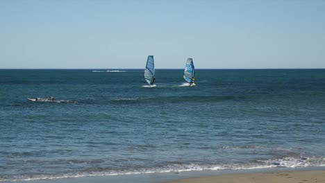 Spain-Cambrils-Two-Windsurfers-Off-Shore