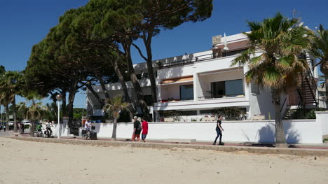 Spain-Cambrils-View-Of-Apartments-With-Bikers-And-Walkers